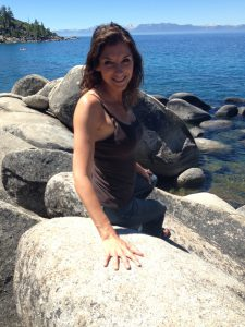 Me on the rocks at Lake Tahoe, where's my paddle board